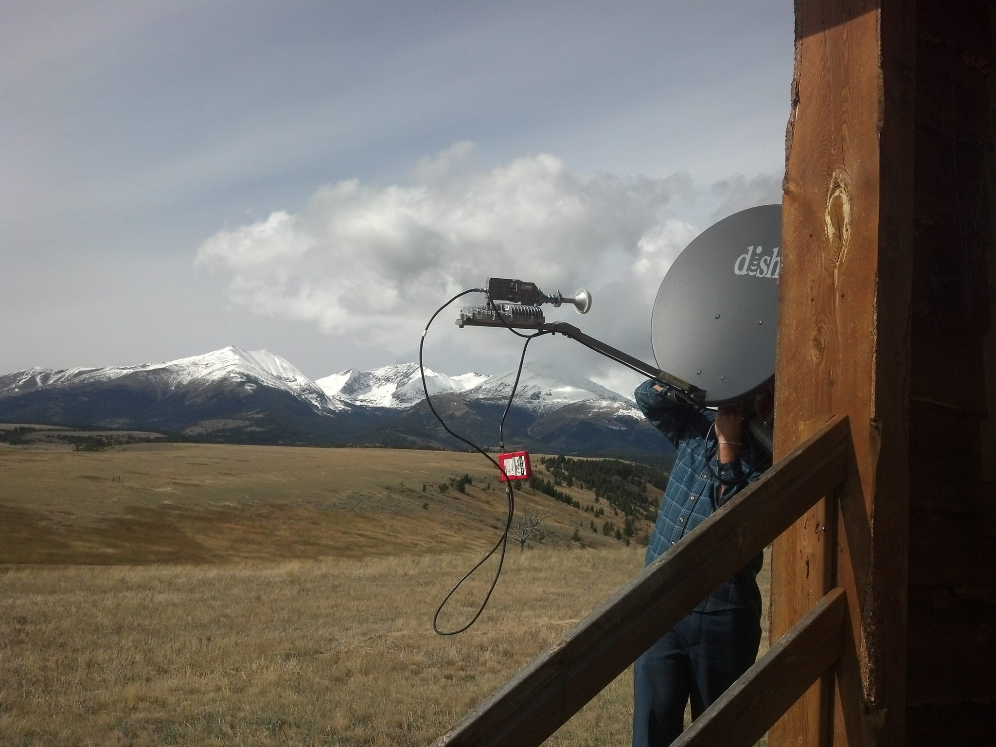 Photo of ARC Satellite installing with a good view of the mountains